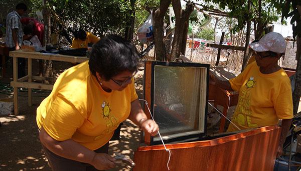 NAPECA - Community Building Sun Ovens